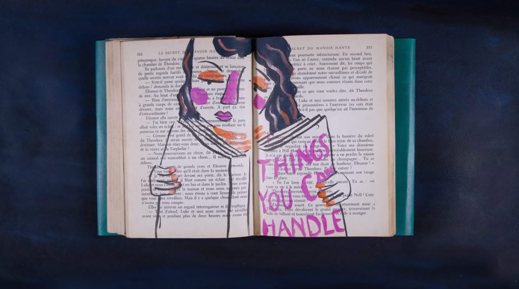 A painting on a book, things you can handle.